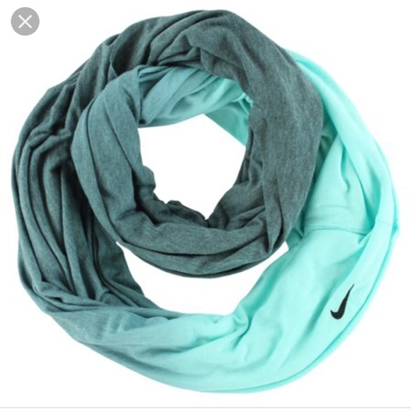 Nike Women s Turquoise Infinity dye dip scarf. Nike.  M 5c3cee75aaa5b8e1555382ce. M 5c3cee7b12cd4a7db8df242b.  M 5c3cee8b9539f73942a7b4a7 9e8e7dd8a